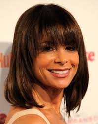 pic of black women side swept bangs and bun hairstyle long layered hairstyles with side swept bangs hairstyle for