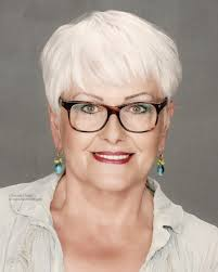 short haircut for older women with white hair who wear glasses