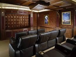 elegant home theater with leather seating and brown wallpaper