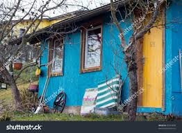 untidy small blue house yellow door stock photo 92314030