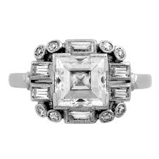 past era art deco square diamond ring in an openwork diamond frame