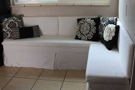 dining room comfy banquette seating with decorative cushions