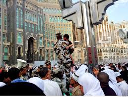 in front of abraj al bait towers outside al masjid al haram on