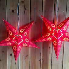 paper star lights red and gold modern day hippie
