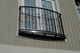 interesting balcony design using wrought iron railing combined