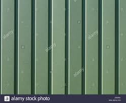 greenery metallic fence made of corrugated steel sheet with