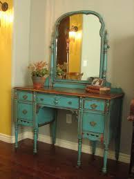 small dark brown polished oak wood vanity table with hafl bull