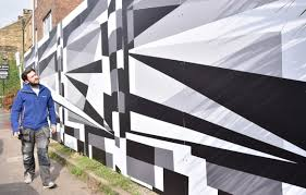 artistic hoardings cover former theatre royal arches on fulford