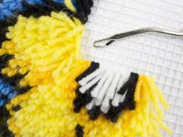 latch hook rug stitch with canvas and yarn stock photo picture
