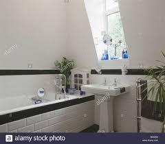 black tiled dado and matching tiled bath edging in modern white
