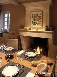 dining table in front of fireplace holiday rental home in france la maison des vignes near bourg