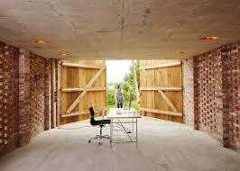 outbuilding of the week garage as lantern in the german wirth architects brick garage gardenista 4