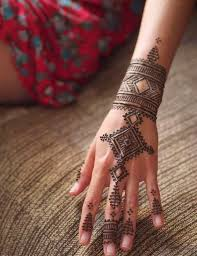 picture of 2temporary henna tattoo with a geometric feel and some