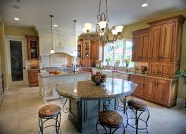 kitchen kitchen island with seating and dining tables open