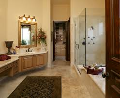 the neutral walls tile floor and glass shower door make this