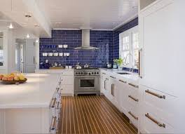 Tidy Kitchen Featured White Cabinets With Modern Appliances And - Blue subway tile backsplash