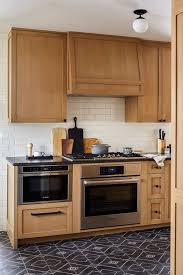 honey oak kitchen cabinets with wood floors how to work with your honey oak to update your 90s home