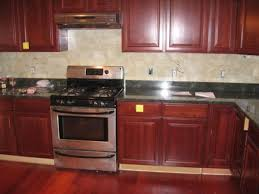 Cherry Wood Kitchen Cabinets With Black Granite Brown Varnished Cherry Wood Kitchen Cabinet On Laminate Flooring