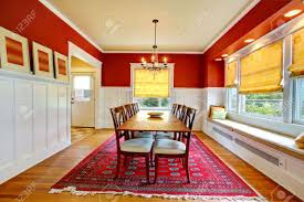 red and white dining room with hardwood floor view of table