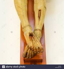 jesus on the cross the crucifixion leg and foot detail stock photo