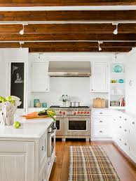 white kitchen with brushed oak engineered wood floors