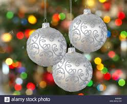three silver balls on tree background stock photo