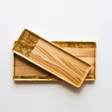 ash serving plates with gold leaf handmade nadine hajjar