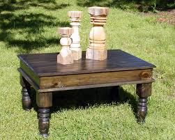 ebony coffee table with beautiful hand carved legs and a
