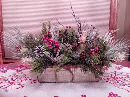 primitive country christmas centerpiece with an old world santa