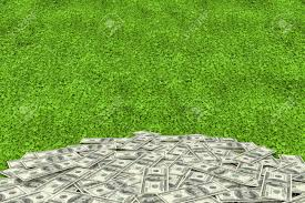 astroturf pile of dollars against astro turf surface stock photo picture