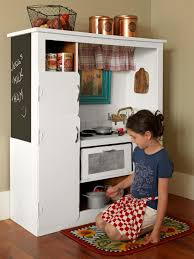 how to turn an old entertainment center into a play kitchen how