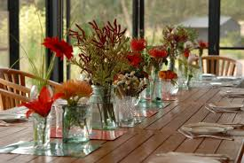 assorted color flowers on the glass vases placed on the brown