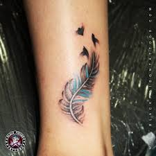 tattoo pictures color feather tattoos and its designs ideas images and meanings black