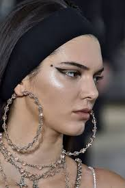 stretchy headbands kendall jenner and cbell wear headbands at givenchy s