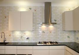 white glass tile backsplash with white cabinet beautiful white