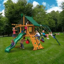 exterior backyard playsets with green fabric roof and natural