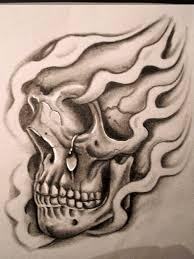 sad skull tattoo deisgn by danleicester on deviantart