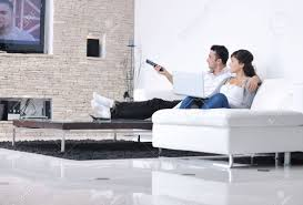 young couple room relaxed young couple watching tv at home in bright living room