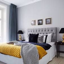 grey and blue decor with yello pop of color bedroom decor