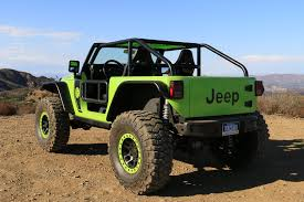 tank green jeep behind the wheel of the 707 hp jeep trailcat concept