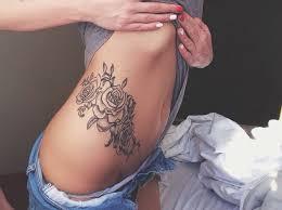 rose tattoo black and shading tattoo high thigh hip