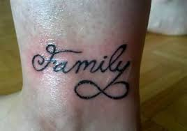 colorful infinity and family on s wrist
