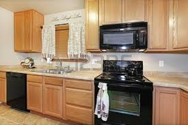 kitchen black brown cabinets and new appliances stock photo