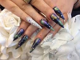 stiletto nails with galaxy nail art and swarvoski fingers nail