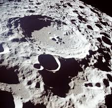 what are craters and why does the moon so many and the earth