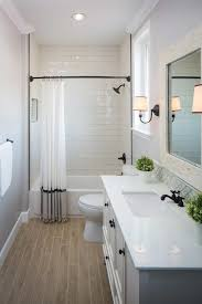 bathroom ideas subway tile guest bathroom with wood grain tile floor subway tile in the
