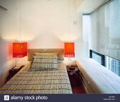 bedroom with orange hanging bedside lights in a modern chinese
