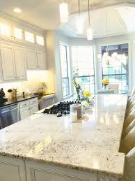 carrara marble backsplash and granite island white dove cabinets
