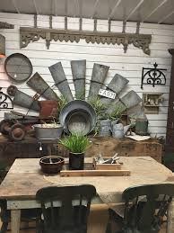 farmhouse decorating using old galvanized rusty gold windmill