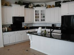 decorations white wooden kitchen cabinet with black granite